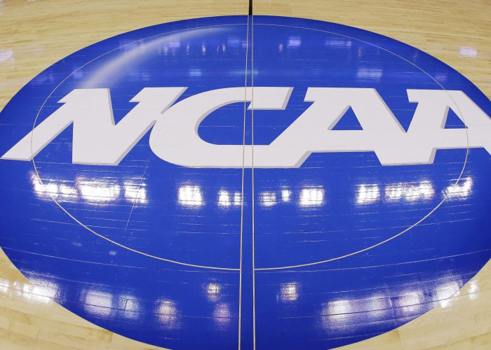 FILE - In this March 21, 2013, file photo, in this image taken with a fisheye lens, the NCAA logo is displayed at mid-court before Albany's practice for a second-round game of the NCAA college basketball tournament in Philadelphia. Barely a month ago, the NCAA was shamed into apologizing for trying to rig its own investigation into funny business at the University of Miami. According to a new report, that apology didn't go nearly far enough. (AP Photo/Matt Slocum, File)