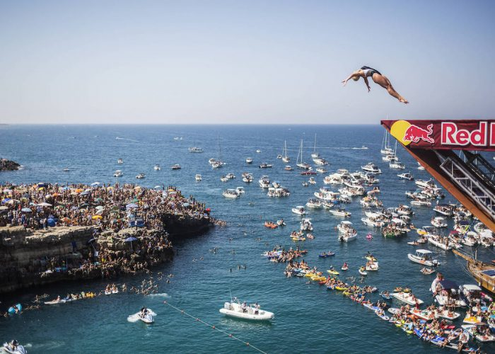 Cesilie Carlton of the USA dives from the 21 metre platform during the first competition day of the third stop of the Red Bull Cliff Diving World Series at Polignano a Mare, Italy on 23 July 2017. // Romina Amato/Red Bull Content Pool // P-20170723-01392 // Usage for editorial use only // Please go to www.redbullcontentpool.com for further information. //