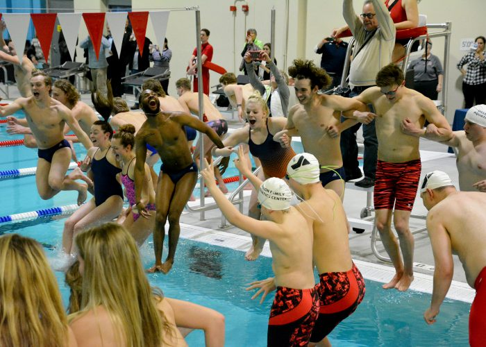 Members of the Midland University Swimming Team join others in diving into the new pool at the Dillon Family YMCA Aquatic Center on Tuesday, Feb. 6, in Fremont, Nebraska.
