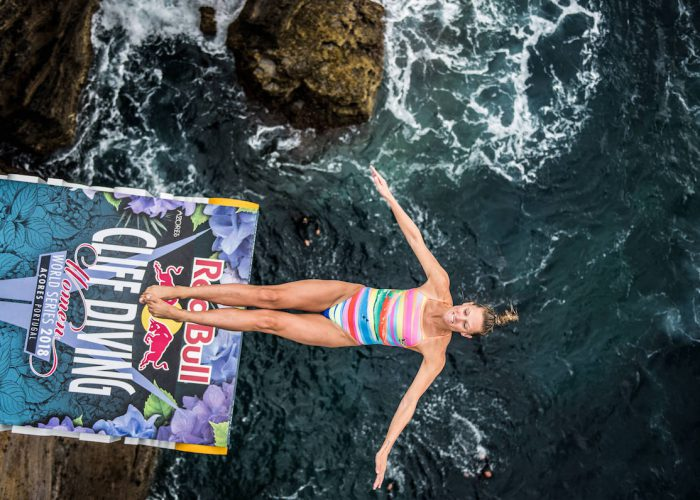 Jessica Macaulay of the UK dives from the 21 metre platform during the final competition day of the third stop at the Red Bull Cliff Diving World Series in Azores, Portugal on July 14, 2018. // Romina Amato/Red Bull Content Pool // AP-1W9D4XN9D2111 // Usage for editorial use only // Please go to www.redbullcontentpool.com for further information. //