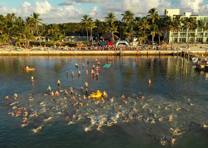 "A portion of a field of more than 350 swimmers begins the ""Swim for Alligator Lighthouse Saturday, Sept. 15, 2018, off Islamorada, Fla. Entrants, divided into single and group divisions, navigated an 8-mile open water swimming course from the Amara Cay Resort in the Florida Keys to Alligator Reef Lighthouse and back. FOR EDITORIAL USE ONLY (Bob Care/Florida Keys News Bureau/HO)"