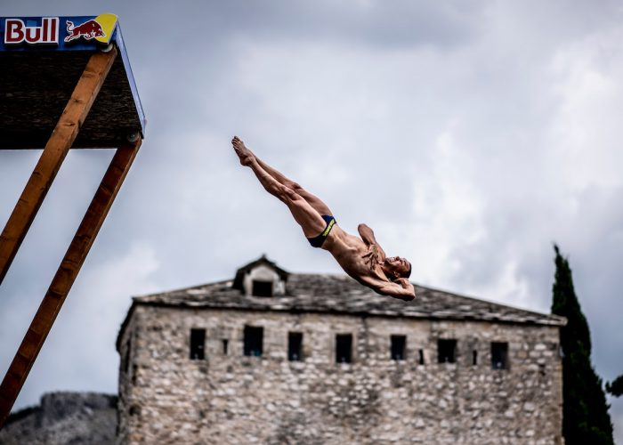Michal Navratil of the Czech Republic dives from the 27 metre platform on Stari Most during the first competition day of the sixth stop at the Red Bull Cliff Diving World Series in Mostar, Bosnia and Herzegovina on September 7, 2018. // Dean Treml/Red Bull Content Pool // AP-1WU1DDTQD2111 // Usage for editorial use only // Please go to www.redbullcontentpool.com for further information. //