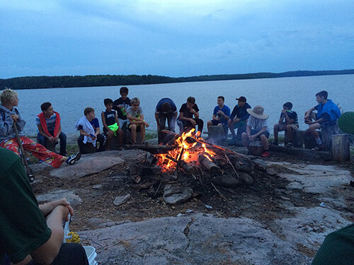 Camp Chikopi fire by lake
