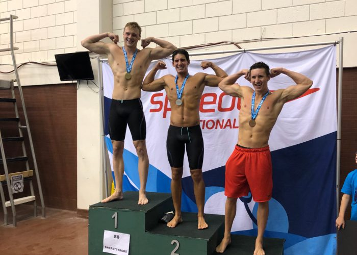 swimmers-flex-on-podium