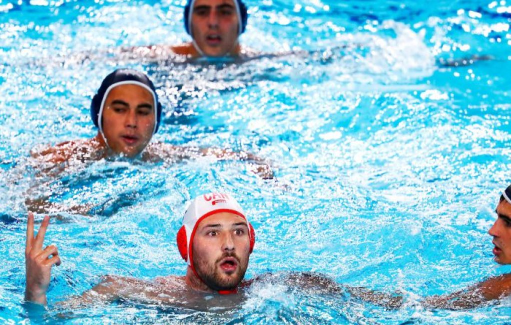 Lima, Monday, August 5, 2019 - Nicolas Constantin-Bicari, left, from Canada reacts to the referee's call during their Men's Water Polo Group Phase match against the USA at the Polideportivo Villa Maria del Triunfo at the Pan American Games Lima 2019. Copyright Marcos Brindicci / Lima 2019 Mandatory credits: Lima 2019 ** NO SALES ** NO ARCHIVES **