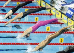 Swimmers of the fourth heat with Jeanette OTTESEN (pink suit) of Denmark, Laura LETRARI (above Ottesen) of Italy, Chantal GROOT (2 above Ottesen) of the Netherlands and Diane BUI DUYET (below Ottesen) of France start in the women's 50m Butterfly Heats at the 13th European Short Course Swimming Championships in Istanbul, Turkey, Friday, Dec. 11, 2009. (Photo by Patrick B. Kraemer / MAGICPBK)