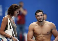 Laure Manaudou (L) talks to her brother Florent Manaudou of France during a training session 1 day prior to the start of the swimming competition during the FINA Swimming World Championships at Kazan arena in Kazan, Russia, 1 August 2015.