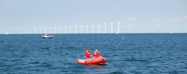 Danielle Kellers billede af to overdommere i en gummibåd på havet ved Amager OW 2011