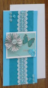 "Blue card for ""A Special Day"". Features raised flower and butterfly motifs."