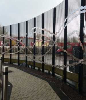 metal art on fence at royal mail office