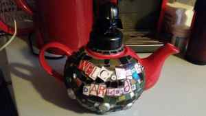 teapot with mosaic and darth vader on it