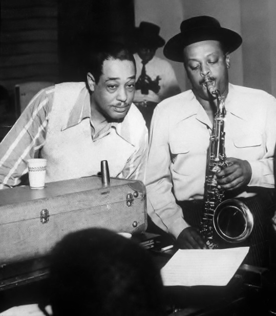 "RAR1077530 Duke Ellington and his orchestra (b/w photo) by American Photographer, (20th century); Private Collection; (add.info.: Edward Kennedy ""Duke"" Ellington (April 29, 1899 – May 24, 1974) was an American composer, pianist and bandleader of jazz orchestras. He led his orchestra from 1923 until he died, his career spanning over 50 years.); FRENCH RIGHTS NOT AVAILABLE; American,  out of copyright"