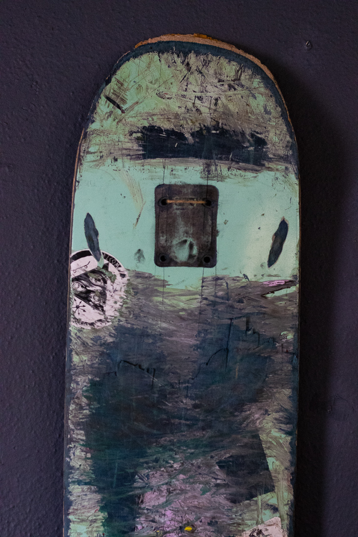 one of many broken skateboards