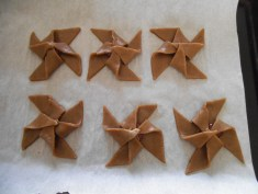 Once all pinwheels are folded into shape, cookies are ready to bake.