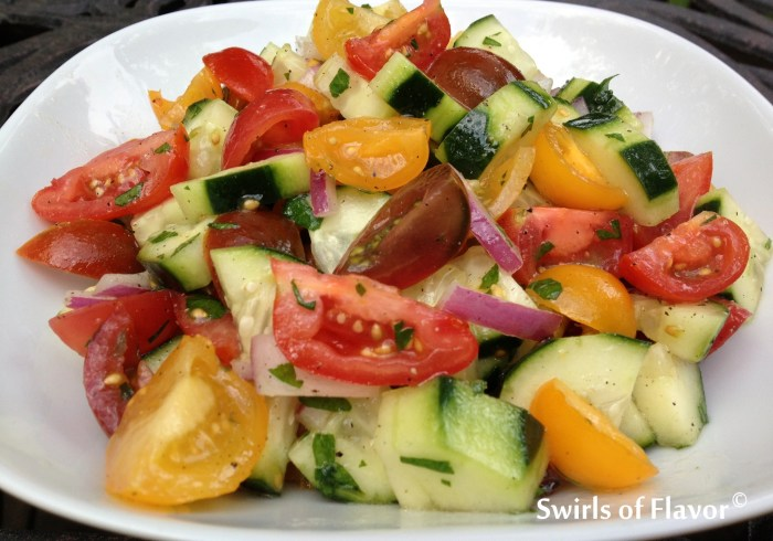 Heirloom Tomato & Cucumber Summer Salad is an easy summer side dish filled with tomatoes and cucumbers lightly coated in a tangy red wine vinaigrette. Farmers market | vegetables | summer recipe | side dish | vinaigrette | easy recipe | #swirlsofflavor