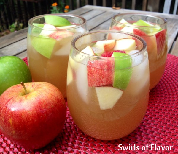 Apple Cider Sangria is an easy recipe that adds a fall spin to your sangria! Apple cider, applejack brandy and a sweet white wine combine with a hint of vanilla to create your new favorite autumn cocktail! #sangria #homemade #homemadesangria #apple cider #applecidersangria #applejackbrandy #fallcocktails #easyrecipe #drinkrecipe #swirlsofflavor