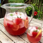 Berry Pink Lemonade Prosecco Punch is flavored with puckeringraspberry lemonade and bubbly Prosecco and topped off with the sweet bursts of fresh berries! punch | Prosecco | berries | strawberry | raspberry | punch | Mother's Day | picnic | summer | drinks | lemonade