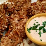 Pretzel Ranch Chicken Tenders is an easy recipe with a crunchy pretzel coating and spicy dipping sauce making them a perfect appetizer for movie night or watching the big game. Serve them with a Buffalo Ranch Dipping Sauce and this baked pretzel-crusted chicken tenders recipe will be a favorite in no time! #chickentenders #bakedchicken #funforkids #easyrecipe #buffalodippingsauce #ranchdippingsauce #bakedchickentenders #pretzelcoatedchicken #pretzelcrust #swirlsofflavor #healthychickenrecipe
