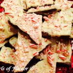 No-Bake Peppermint Bark Cookies....a twist on a holiday favorite! White chocolate surrounded by peppermint candy and chocolate cookies are guaranteed to be a hit on your holiday table! And so easy to make as a last minute sweet treat! #peppermint #peppermintbark #holiday #Christmas #cookies #nobake #dessert #candycane #whitechocolate #chocolategrahamcrackers #swirlsofflavor