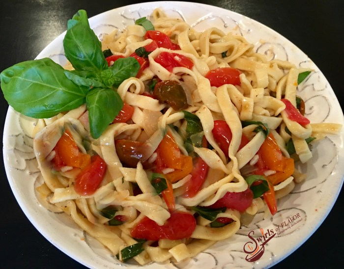 Fettuccine & Buttery Fresh Basil Tomato Sauce! Tender homemade pasta coated in a buttery white wine sauce seasoned with flecks of fresh basil and juicy perfectly wilted heirloom tomatoes! farmers market | heirloom tomatoes | fresh basil | white wine | butter sauce | homemade pasta
