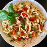 Fettuccine & Buttery Fresh Basil Tomato Sauce! Tender homemade pasta coated in a buttery white wine sauce seasoned with flecks of fresh basil and juicy perfectly wilted heirloom tomatoes!