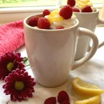 "Raspberry Lemon Mug Cake, ""baked"" in the microwave, topped with whipped topping, lemon curd and fresh raspberries, will show mom just how much you love her.  #mugcake #MothersDay #raspberry #lemon #nobake #dessert #easyrecipe #swirlsofflavor"