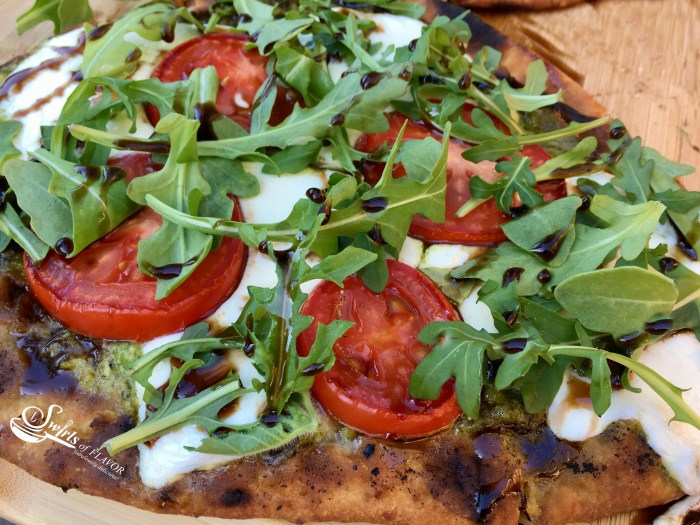 Grilled Pesto Caprese Naan Pizza is bursting with the summertime flavors of fresh mozzarella, plum tomatoes and fresh pesto! Perfect for Meatless Monday! pizza | grilling | caprese | pesto | Meatless Monday | appetizer | tomatoes | mozzarella | quick and easy dinner