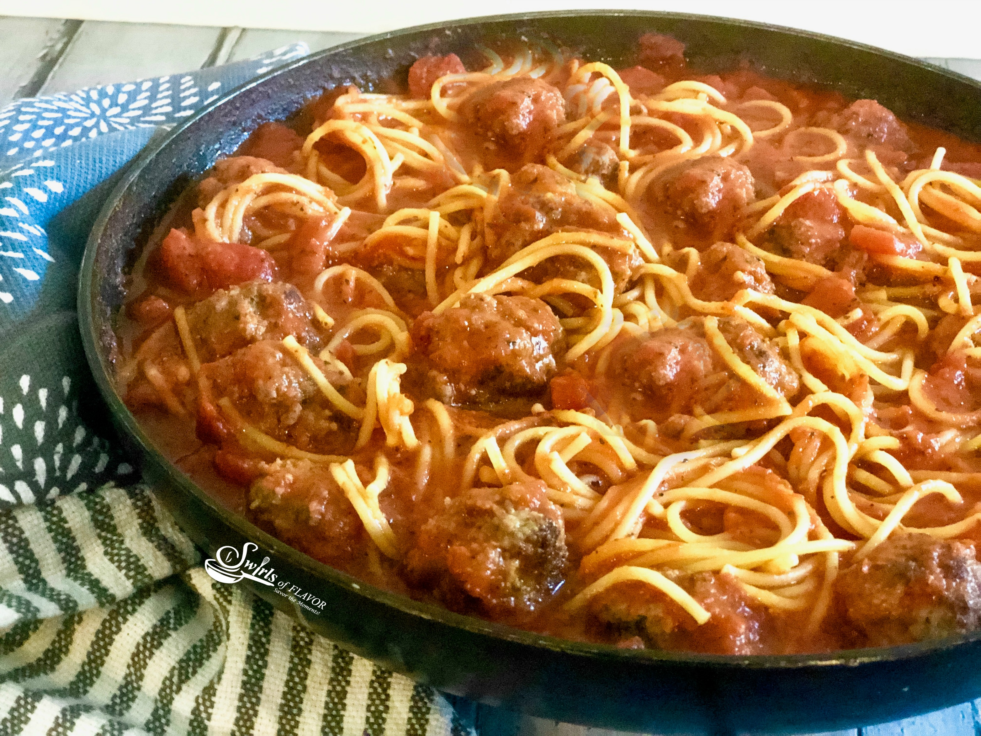 Spaghetti and meatballs in skillet