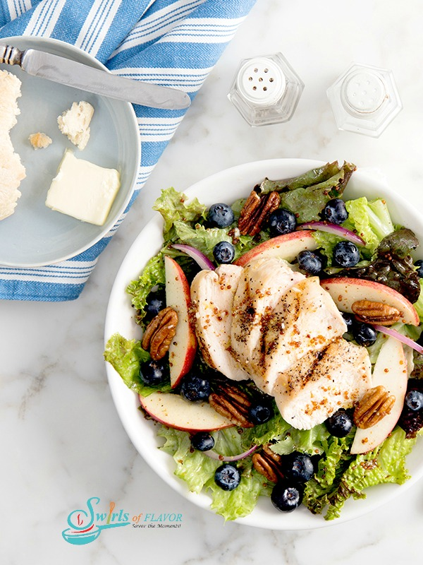 Tossed salad with apples, blueberries, pecans and sliced chicken