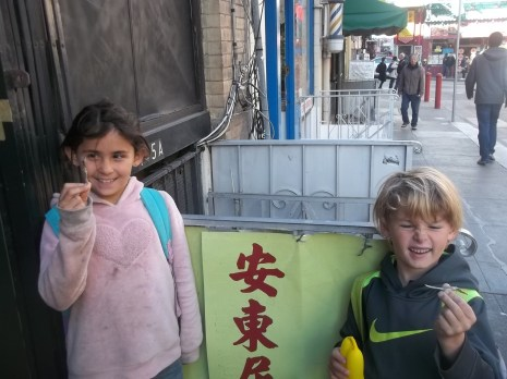 Kids trying the dried sardines