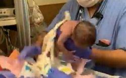 医療スタッフが赤ん坊を落とし、その後脳内出血に!問題の動画が公開される