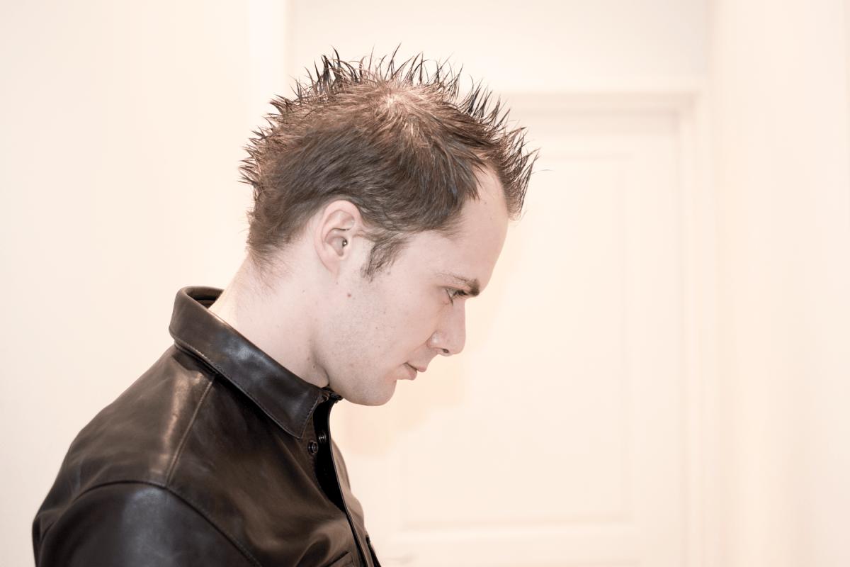 SlaveLDN side profile shot wearing Master U leather shirt