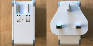 Zikko eLuggage L charger with built-in US plug and connected UK plug.