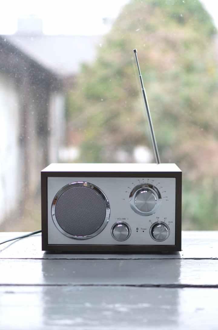 small retro radio set on wooden windowsill