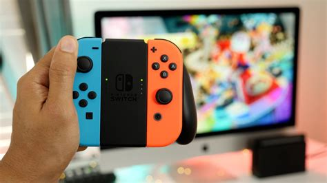 neon joy cons in a grip with mario kart 8 deluxe in the background