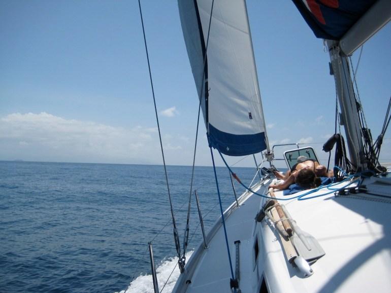 Bikini babe on deck of boat
