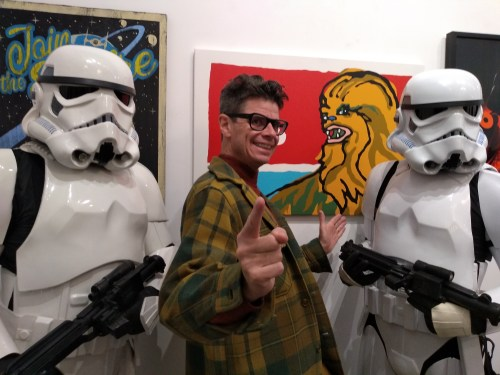 Artist Rob Elliott with stormtroopers.