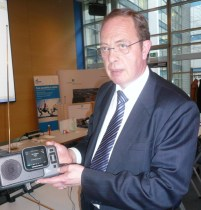 Uniwave SA, CEO, Patrick Leclerc, with the receiver holding the Di-Wave 100. Photo courtesy of DRM consortium.