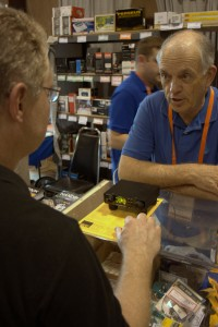 CommRadio's president, Don Moore, working with a customer at the Universal Radio booth.