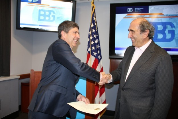 Jeff Shell, Chairman of the Broadcasting Board of Governors, congratulates Andy Lack after swearing him in as the first ever CEO of U.S. international media. (Image Source: BBG Press Release)