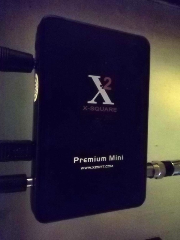 X-Square FTA receiver, about the size of a cigarette pack.