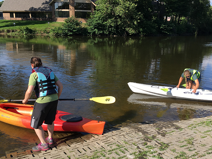 A couple of paddlers getting ready to launch their kayaks into the Kalamazoo River.