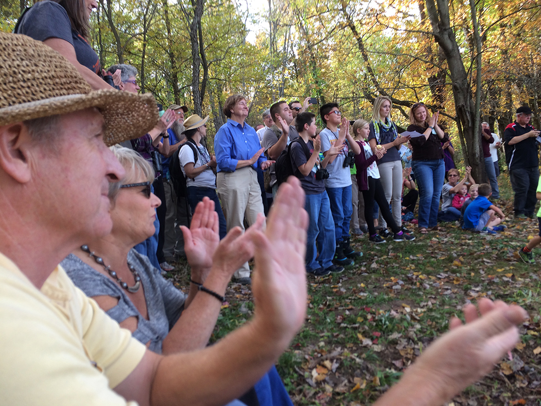 People gathered at the site of the future Mud Lake Overlook for a ribbon-cutting ceremony and acknowledgements.