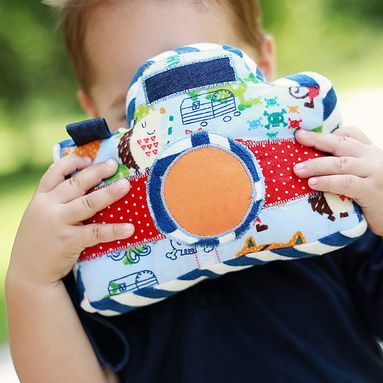 Little Photographer Camera - Swoodson Says. A softie perfect for imaginative play, including a vinyl pocket in the back to insert real photos.