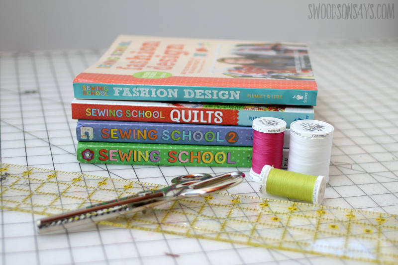 stack of books for teaching kids to sew