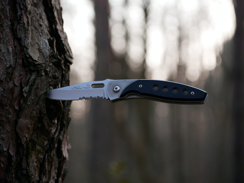 Folding knife embedded in tree