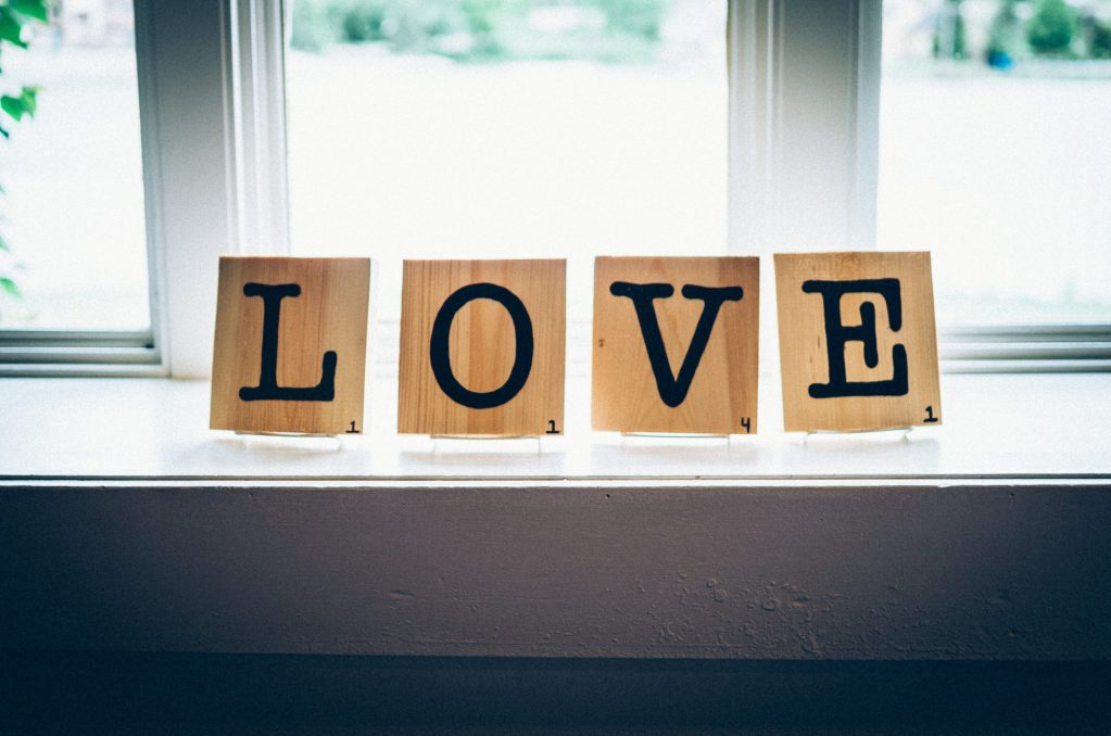 blocks spelling out the word love on a window sill