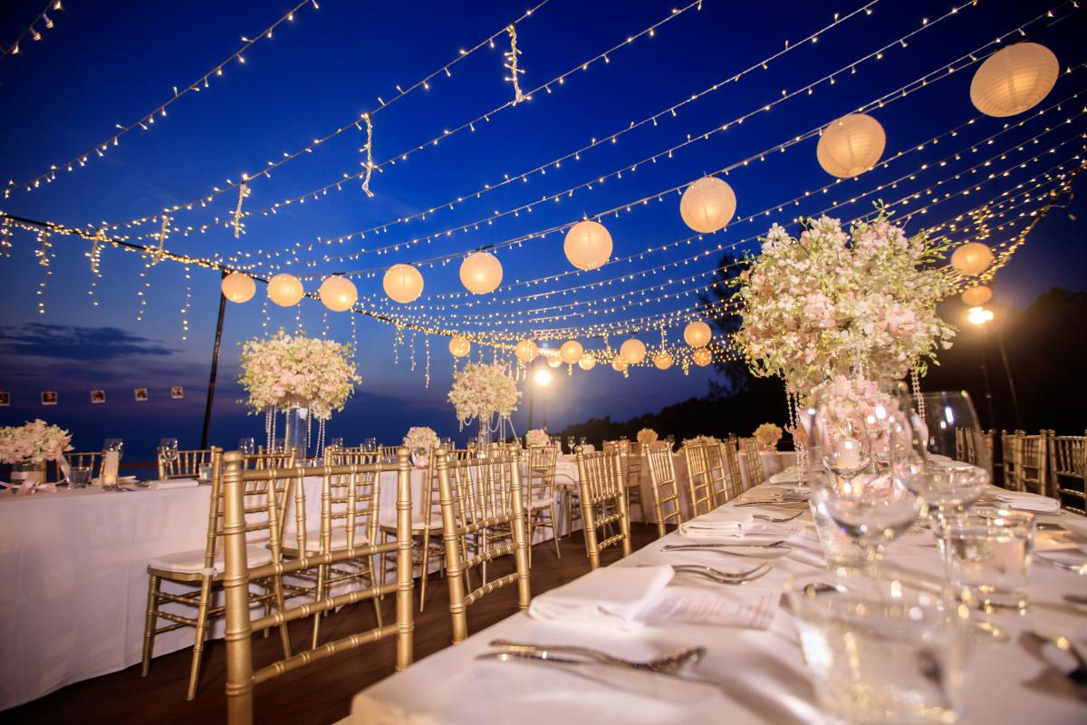 illustrates an example of some wedding and event rentals at night