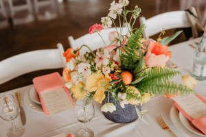 to show wedding flowerson a rental table with rental chairs