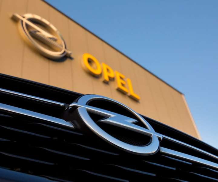 A badge sits on a new Opel Astra automobile, manufactured by General Motors Co., as it stands outside an Opel dealership in Berlin, Germany, on Tuesday, Feb. 14, 2017. PSA Group's proposal to buy General Motors' Opel brand quickly ran into headwinds in Germany, with political and labor leaders vowing to protect jobs and the unit's manufacturing footprint in the country. Photographer: Krisztian Bocsi/Bloomberg via Getty Images
